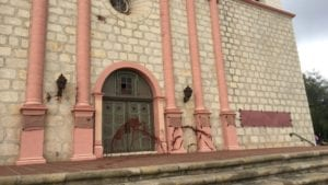 Red paint could be seen at Old Mission Santa Barbara Wednesday morning and signs covering up other words written by vandals. (KSBY photo)