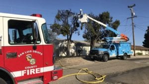 A PG&E worker helps put out a fire in Nipomo Friday. (KSBY photo)