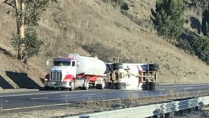 A big rig trailer overturned on southbound Highway 101 south of LOVR in SLO Thursday morning. (KSBY photo)