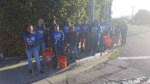Students help pick up trash in the V Street Channel Saturday. (Courtesy photo)