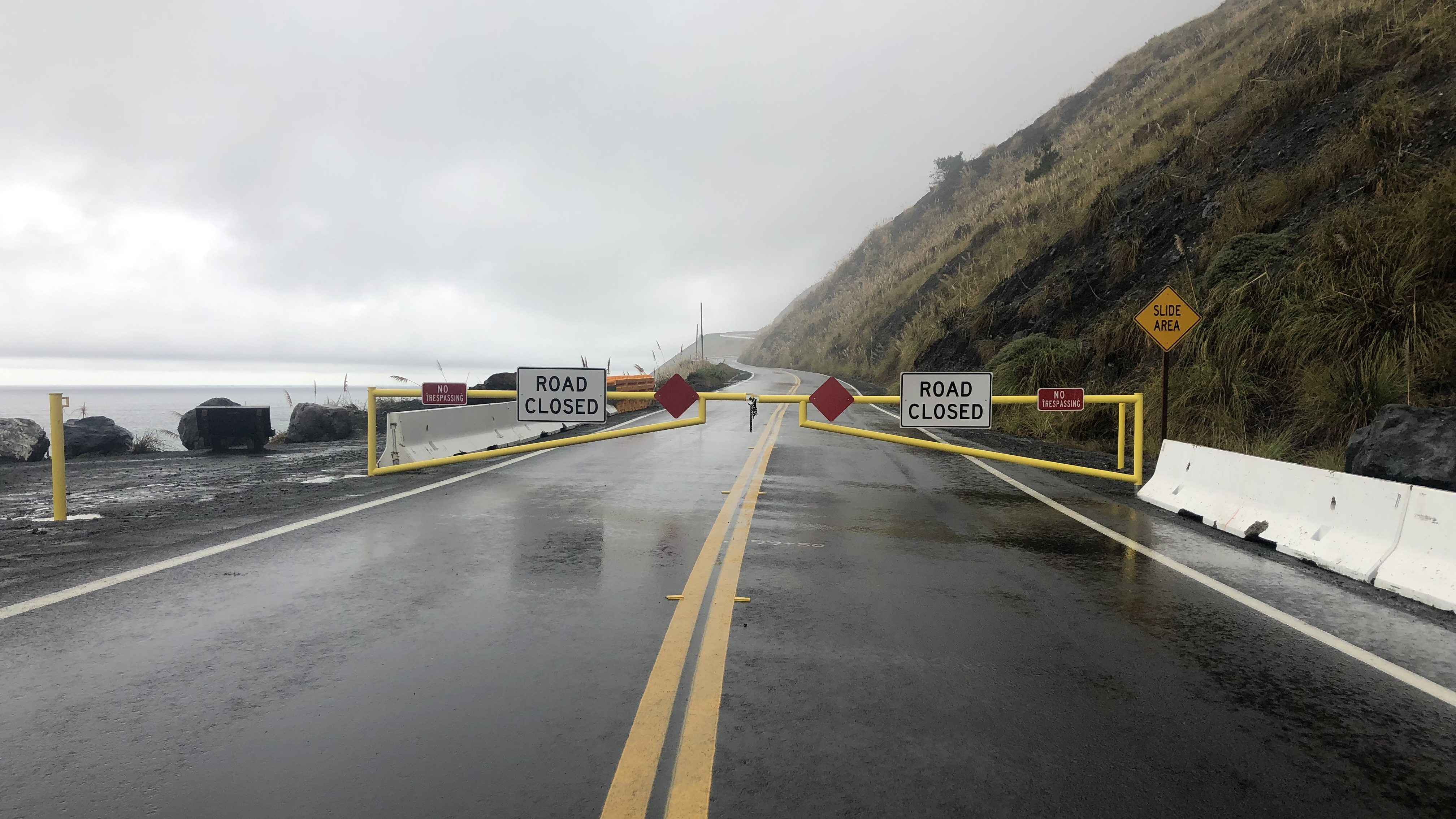 Recently-installed gates prevent traffic from driving through the Mud Creek Slide area. (KSBY photo)