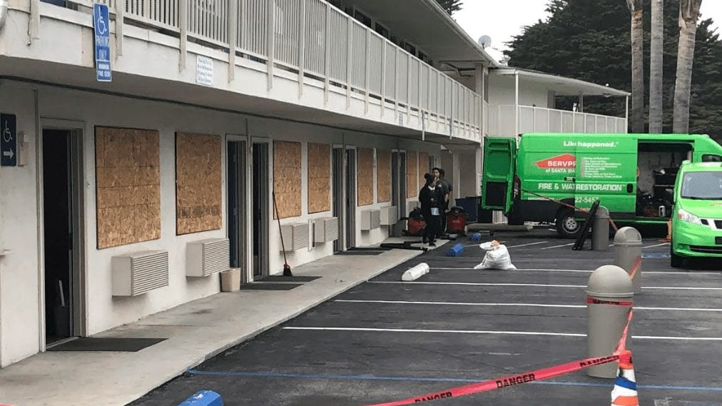 Widows are boarded up at Motel 6 in Morro Bay after being damaged Wednesday evening. (KSBY photo)