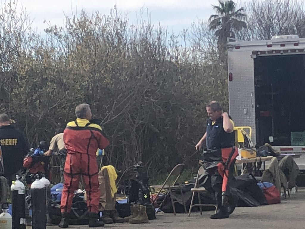 Members of the SLO Co. Sheriffs dive team suiting up in Oceano Monday morning. KSBY photo