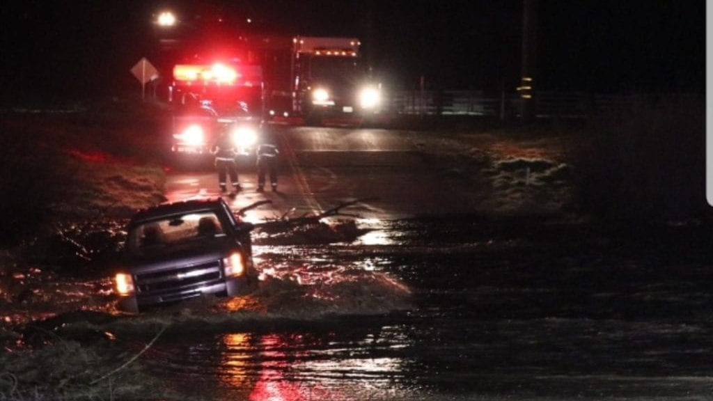 A vehicle stuck in water along North River Road Thursday morning. (Photo: Jason Brock)