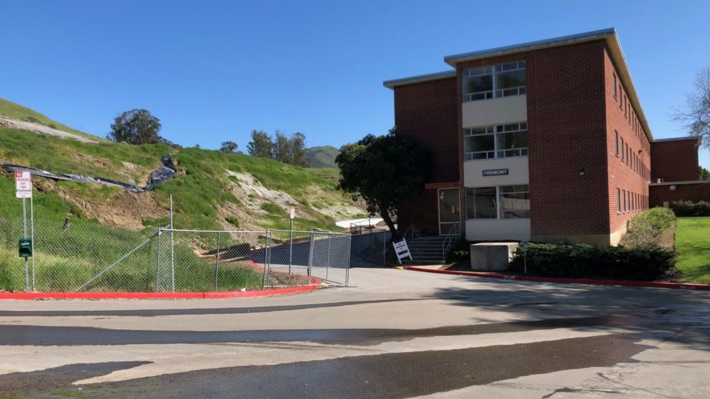 The hillside near Cal Poly's Fremont Dorm remains fenced off. (KSBY photo)
