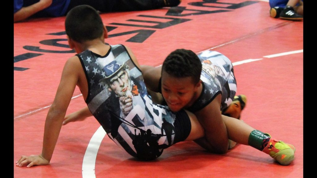 Poker Night raises funds for youth wrestling champs