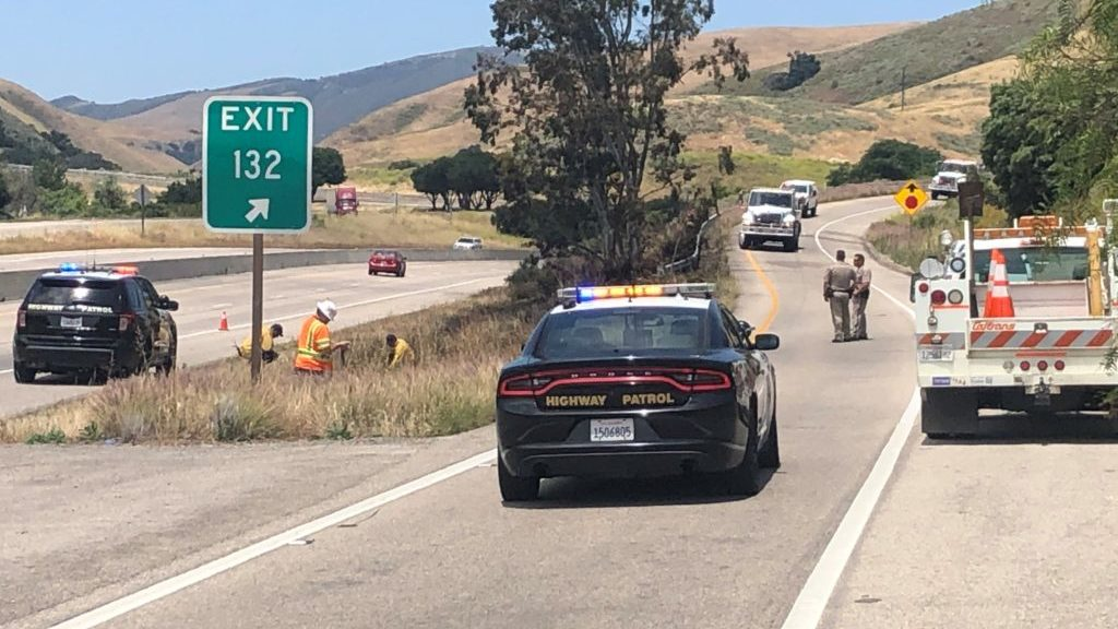 Firefighters, CHP and Caltrans crews at the scene of a grass fire along Highway 101 outside Gaviota Tuesday afternoon. (KSBY photo)